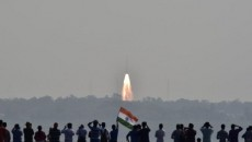 People watch as India's PSLV-C37 carrying 104 satellites in a single mission lifts off from the Satish Dhawan Space Centre in Sriharikota